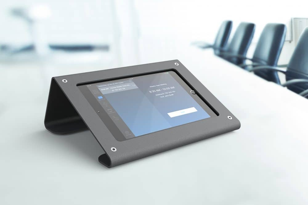 Lifestyle Image of Heckler Meeting Room Console on Conference Table with iPad Powered On